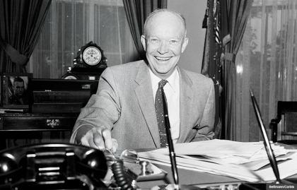 President Dwight Eisenhower president 1957 oval office smiling portrait desk radio