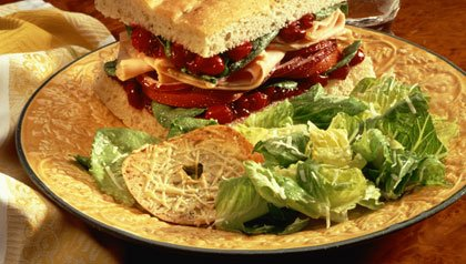 Turkey and cranberry sandwich with salad