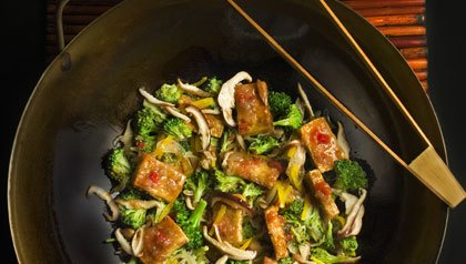 Tofu stir-fry in a wok.