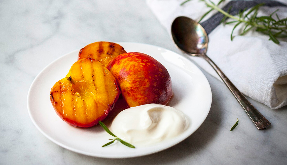 Grilled Peaches, yogurt, spoon, Chefs Healthy Summer Recipes, AARP, Diet & Nutrition