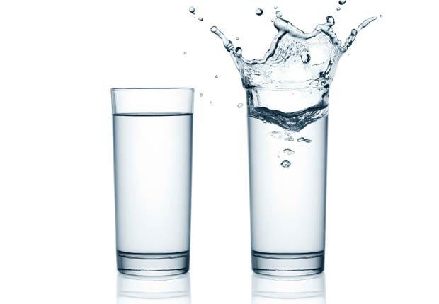 two glasses of water with splash