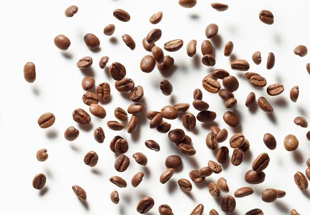 bouncing coffee beans shot on white