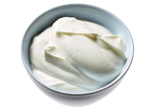Greek Yogurt in a bowl, shot on white