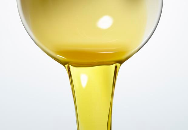 Olive Oil being poured out of bowl