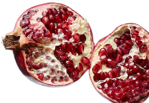 Pomegranates shot on white