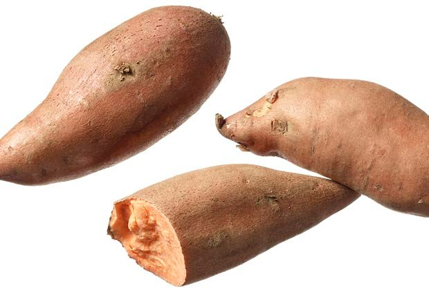 Sweet potatoes shot on white