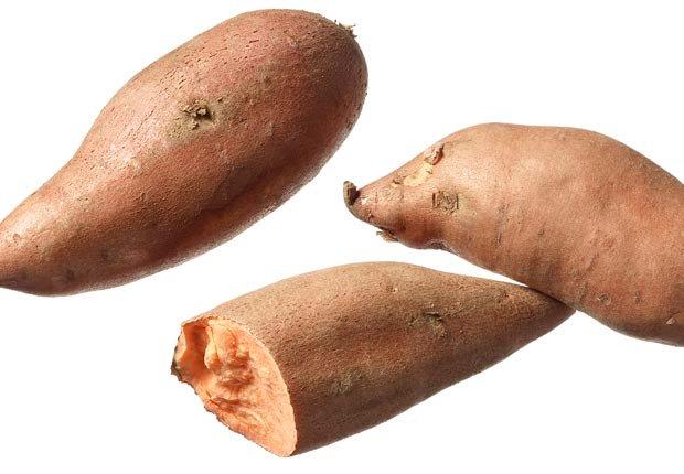 Sweet potatoes shot on white