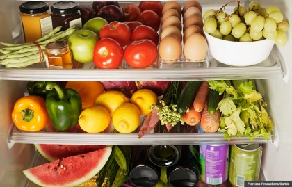 Packed Refrigerator Shelves of Fruits and Vegetables, Eat To Prevent Colon Cancer