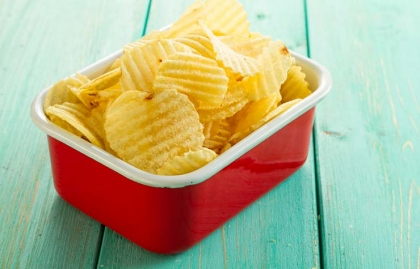 Potato chips in red bowl