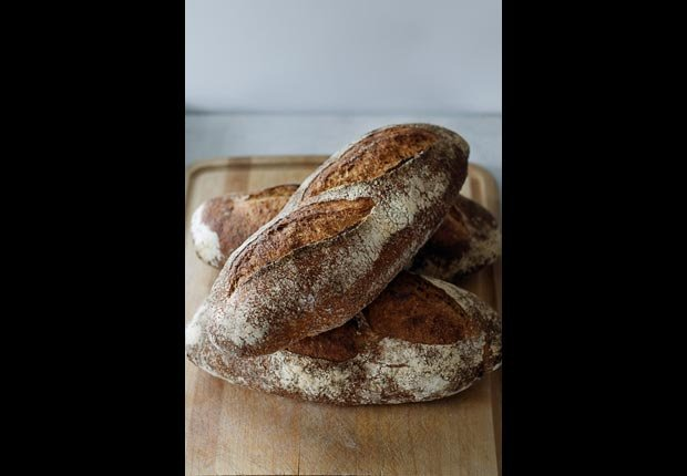Rustic French Whole Wheat Bread On A Cutting Board, calorie dense foods