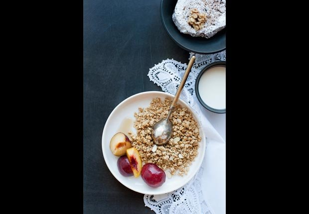 Plate of granola with fruit and cream, calorie dense foods