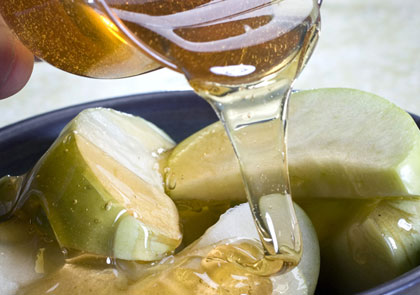 honey poured over apples