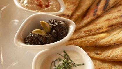 Flatbread with tzaziki, hummus and black olive tapenade