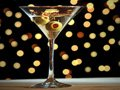 Classic martini with olives and holiday background, Holiday Cocktail Recipes