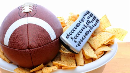 TV remote with a bowl of chips and football, 10 Football Party Appetizers