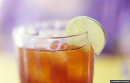 Iced tea with lemon garnish, Cookstr Recipes for summer party drinks (Randy Wells/Getty Images)