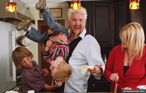 Guy Fieri and his family cooking in the kitchen, Family Food (Lisa Romerein/Corbis Outline)