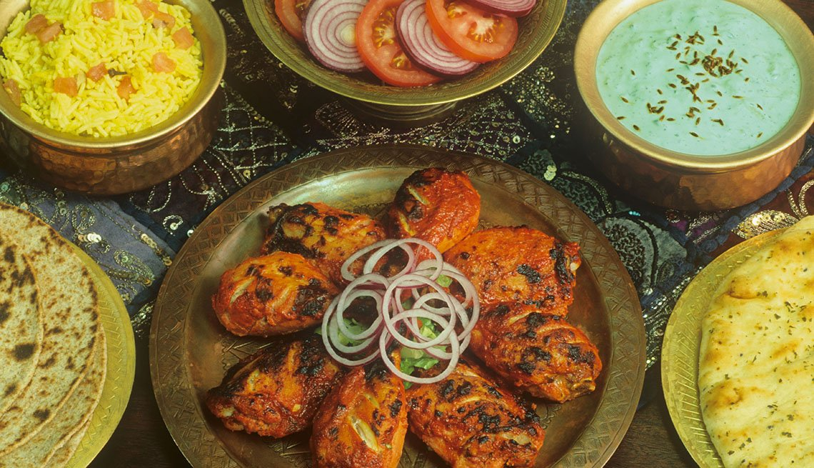 Tandoori Chicken With Cucumber Raita, Tomato Salad, CousCous And Naan, Indian Food, AARP Food And Recipes, Authentic Asian Dishes