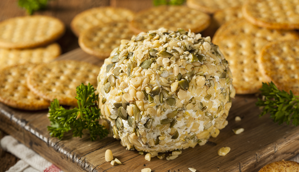 Nut Encrusted Cheese Ball on a Board with Crackers, 8 Healthy and Easy Super Bowl Snacks