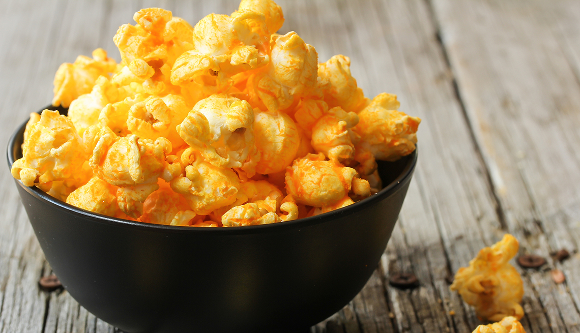 Orange and Yellow Popcorn in a Black Bowl, Weathered Wood Table, 8 Healthy and Easy Super Bowl Snacks