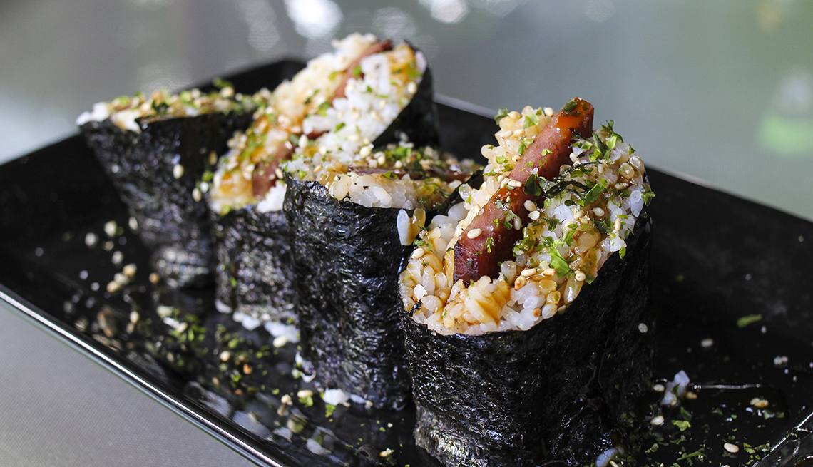 Spam Musubi wraps sitting on a black plate