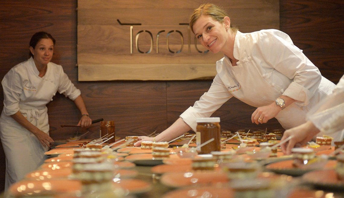 Chef Pati Jinich plating food on a table.