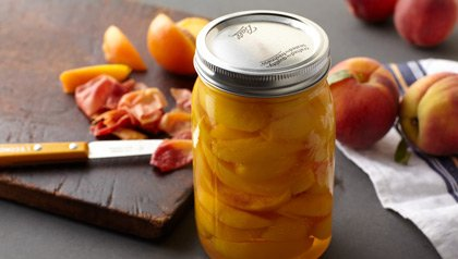 jar of freshly canned peaches