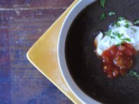 Black bean soup with cumin and salsa verde