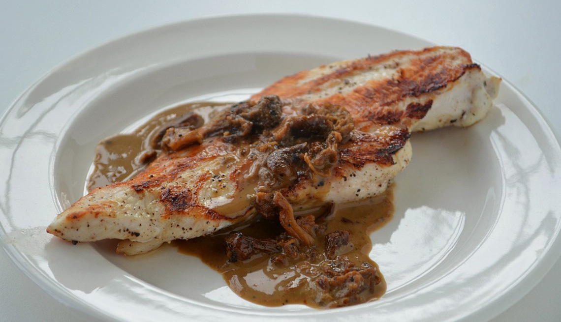 Creamy Mushroom Sauce On Top Of Chicken Cutlet, AARP Food And Recipes, Eight Healthy Chicken Recipes