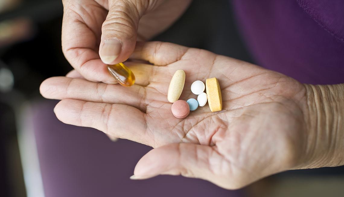 Píldoras en un mano