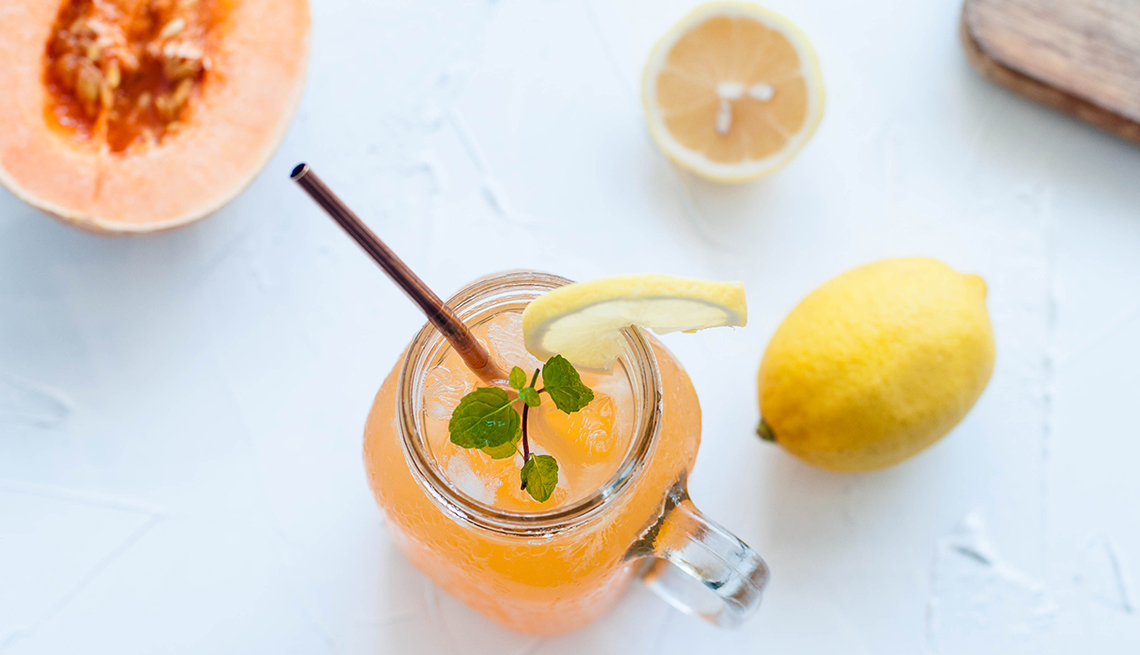 overhead image of a mocktail with citrus and melon