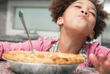 child eating pie