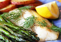 Roasting fish and vegetables provides a healthy meal quickly in one pan.