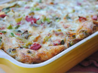Easy strata with roasted red and green peppers