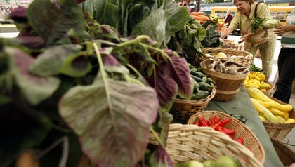 Customers shop for produce at the Food Project's Farmer's Market in the Boston neighborhood of Dorchester
