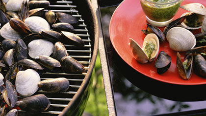 Mussels and clams with pesto on outdoor grill, a 10-minute topping recipe for grilled fish