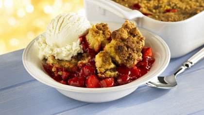 Bowl of strawberry cobbler with ice cream