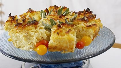 Kugel on Serving Platter for Hanukkah Dinner