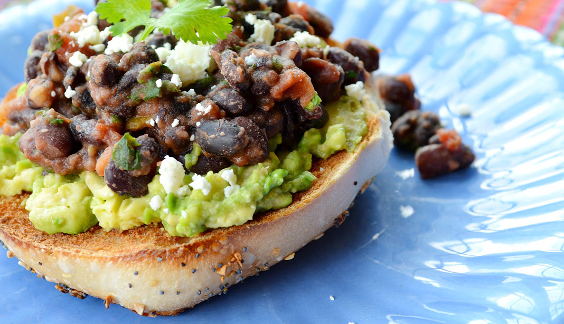 Quick and easy healthy breakfast recipe ideas bagel topped with black beans and guacamole hearty breakfasts forumfinder Choice Image