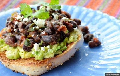 Toasted Open-Faced Bagel with Guacamole and Spicy Black Beans, Pam Anderson Breakfast Recipes to Keep You Fueled Until Lun