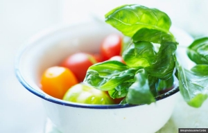 Assorted tomatoes and basil, Cookstr recipes for cooking with basil (Bilic/photocuisine/Corbis)