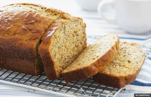 Sliced loaf of banana bread. Quick bread recipes. (Bon Appetit/Alamy)