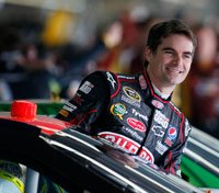 Jeff Gordon climbs into his car