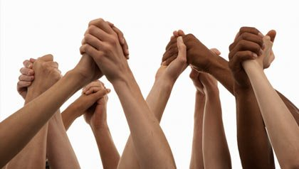 Arms raised holding hands-microgiving to charities online