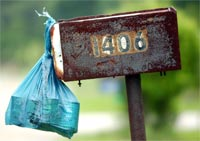 A bag of can goods hung from a mailbox waits to be picked up by a letter carrier during the National Letter Carriers Association annual food drive.
