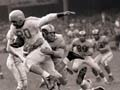 George Taliaferro runs the football