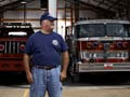 Firefighter John Battistoni in front of a fire engine in Branson, Missouri
