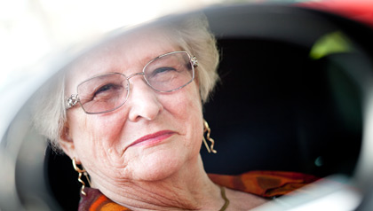 Doris Morse, seen in side view mirror, teachs in the AARP Driver Safety Program.