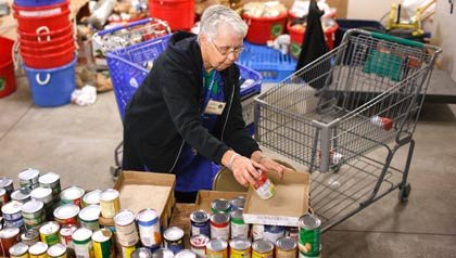 Volunteers in Oregon stock food banks through the Drive to End Hunger