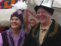 Ginger and Fritz Morrison in traditional Kyrgyz dress during Kyrgyz Culture Day.